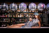 Sexy young woman lying on the bar at a nightclub