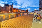 GDANSK, POLAND - 25 JULY 2014: New promenade at Motlawa river in city center of Gdansk. Gdansk is the historical capital of Polish Pomerania with medieval old town architecture.