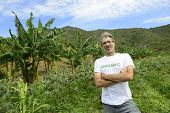 Sustainable agriculture: Organic farmer in front of farmland