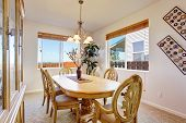 Beautiful Carved Wood Dining Table Set In Bright Room