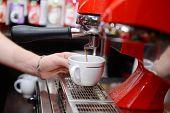 Coffee machine preparing cup of coffee, close up