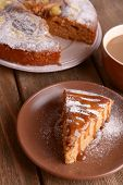 Delicious cake and cup of coffee on wooden table