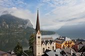 The most picturesque small town in Austria - Hallstatt. Slender belfry and Lutheran church on the s