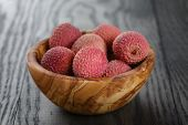 Ripe Lychees In Wood Bowl