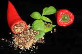 Red Sweet Peppers, Filled With Peppercorn Mix, And Basil Leaves