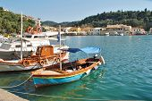 PAXOS, GREECE - JUNE 21, 2014: Small boats moored in the harbour at Lakka on the Greek island of Paxos. Lakka is the Northern harbour of the 13km long Ionian island.