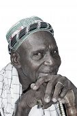 Old African man wearing traditional clothing, isolated