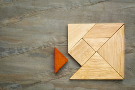 picture of tangram  - a missing piece in a square built from tangram pieces - JPG