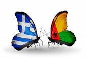 Two Butterflies With Flags On Wings As Symbol Of Relations Greece And Guinea Bissau