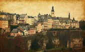 Skyline of Luxembourg City. Photo in retro style.  Added paper texture