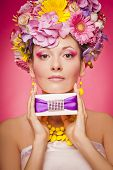 Woman with gift box and flowers hair