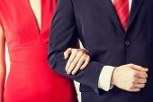 couple with wedding ring holding each other hands