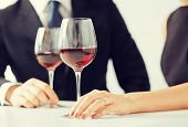 picture of engaged couple with wine glasses in restaurant