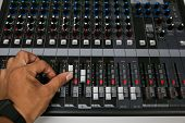 Hand on a Mixing Desk Fader in Television Gallery, Music equipment in training room.