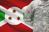 stock photo of burundi  - American soldier with flag on background  - JPG