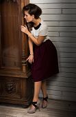 picture of pendulum clock  - Beautiful woman playing hide and seek by the vintage clock - JPG