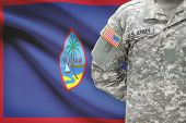 picture of guam  - American soldier with flag on background  - JPG