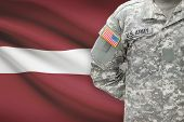 American Soldier With Flag On Background - Latvia