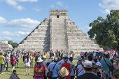 CHICHEN ITZA - JANUARY 19: Tourists visiting Chichen Itza, one of the most visited sites in Mexico on 19 January 2015 in Chichen Itza, Mexico. It is one of new 7 wonders in the world.