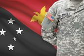 stock photo of papua new guinea  - American soldier with flag on background  - JPG