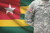American Soldier With Flag On Background - Togo