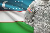 American Soldier With Flag On Background - Uzbekistan
