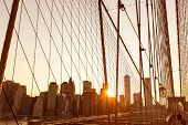 Brooklyn Bridge sunset with Manhattan skyline of New York City USA