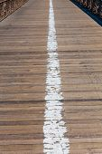 Brooklyn bridge wooden soil pavement detail way to Manhattan New York
