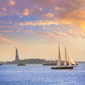 New York sailboat sunset and Statue of Liberty from Manhattan US