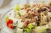 Fresh prepared salad in a bowl to take