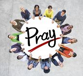 Group of People Holding Hands Around Letter Pray