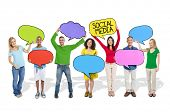 People Holding Colorful Speech Bubbles with Social Media Symbols