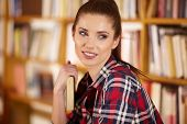 Female college student in a library (shallow DOF; color toned image)