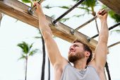 picture of swing  - Exercise fitness athlete exercising on monkey bars - JPG