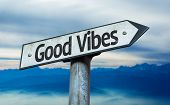 Good Vibes sign with sky background
