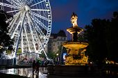 Ferris Wheel And Monument