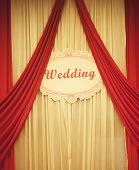 stock photo of banquet  - Chinese traditional red wedding banqueting hall curtains with wedding sign in English language - JPG