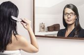 Woman Combing Her Hair With Different Reflection