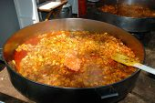 Large paella cooking.