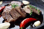 Steak in frying pan close up
