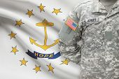 American Soldier With Us State Flag On Background - Rhode Island