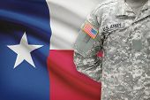 stock photo of texas state flag  - American soldier with US state flag on background  - JPG