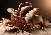 Tasty bread on table on brown background