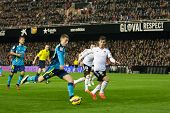 VALENCIA, SPAIN - JANUARY 25: Deulofeu (L) in action during Spanish League match between Valencia CF and Sevilla FC at Mestalla Stadium on January 25, 2015 in Valencia, Spain