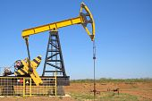 stock photo of nonrenewable  - oil pump jacks working at dawn - JPG