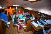 HYDRA, GREECE - CIRCA OCT, 2014: Unidentified sailors on skipper's briefing in the yacht wardroom during sailing regatta 12th Ellada Autumn 2014 among Greek island.