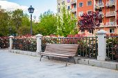 Bench In Front Of A Typical Residetial Building In Madrid