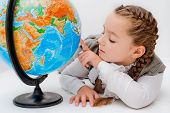 Girl with a globe on  white background