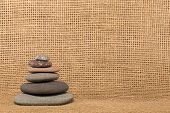 Stone Cairn And Burlap Background