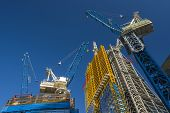 stock photo of building exterior  - Construction Cranes - JPG